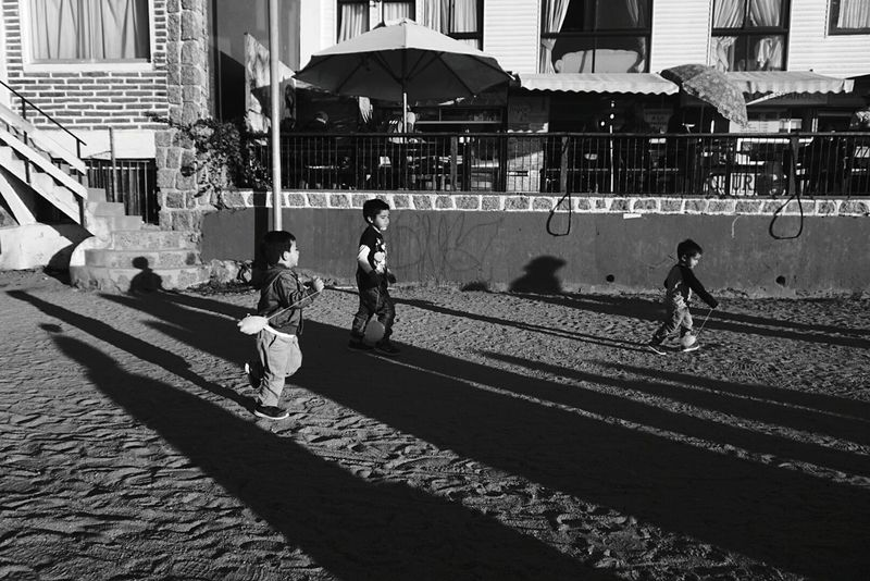 Shadow Real People Sunlight Lifestyles Day Kids Being Kids Kidsphotography Kids Playing Kids Toys Kids Of EyeEm outdoors People Men Sport Full Length City Architecture Adults Only Only Men Black And White Collection  Break The Mold Welcome To Black Scenics Boys Child Outdoors