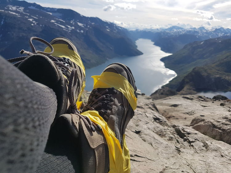 Struggle Brokenshoes Hikingshoe Fixed Tape EyeEm Selects Mountain Human Leg Personal Perspective One Man Only One Person Shoe Low Section Leisure Activity Adventure Human Body Part