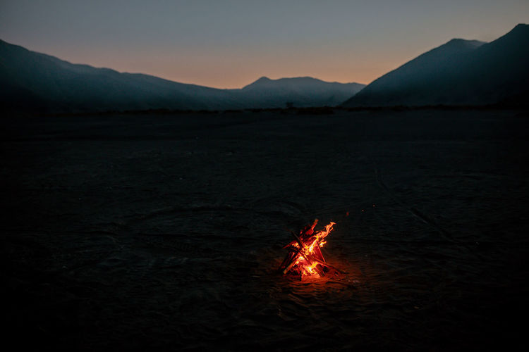 Bonfire against sky at sunset