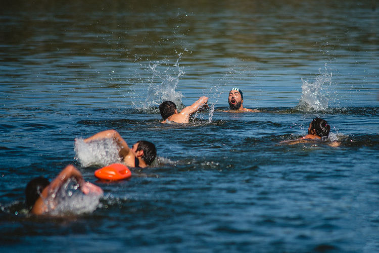 Water Swimming Group Of People Motion Leisure Activity Men Real People Day Sea Waterfront Nature Enjoyment Lifestyles Splashing People Selective Focus Child Trip Outdoors