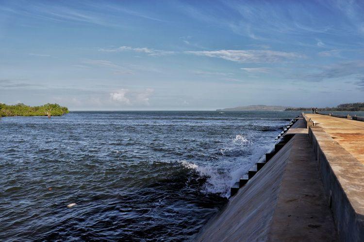 Water breaks on the sea port.
