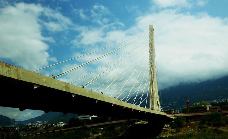 Connection Bridge - Man Made Structure Engineering Sky Suspension Bridge Architecture Built Structure Transportation Bridge Low Angle View Outdoors Day Cloud - Sky No People City