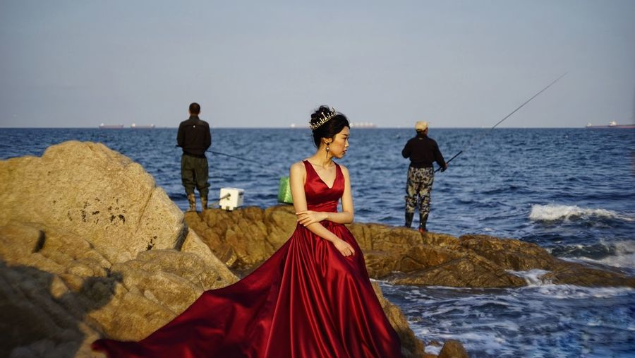 Wedding Adult Beach Clothing Couple - Relationship Day Fashion Horizon Horizon Over Water Land Nature Outdoors People Rock Rock - Object Sea Sky Solid Standing Two People Water Women
