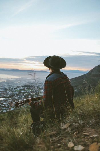 Man Playing Guitar On Mountain