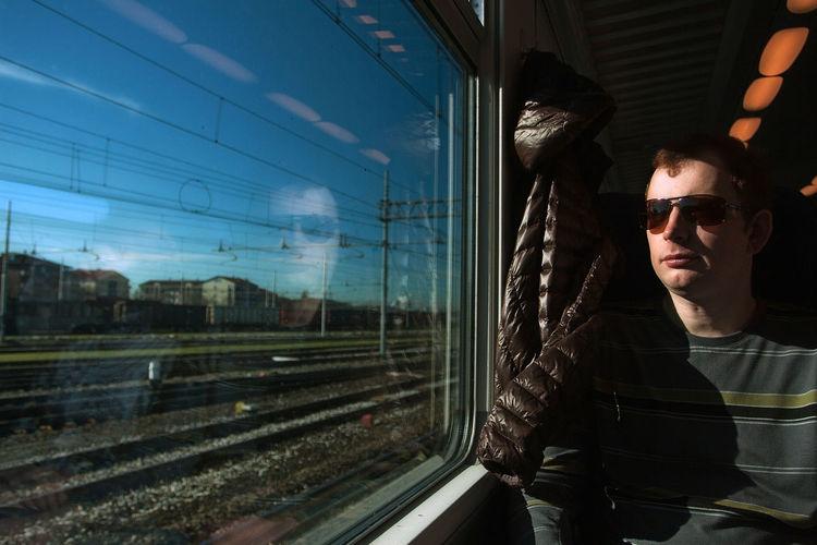 Portrait of man in train