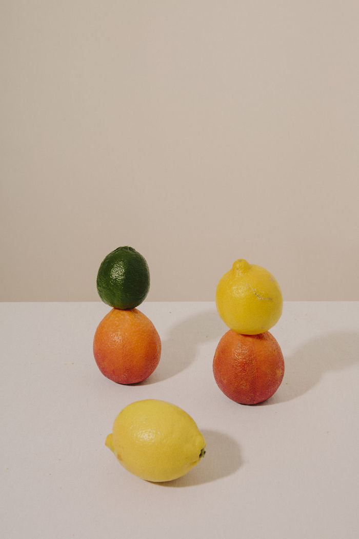 CLOSE-UP OF FRUIT ON TABLE