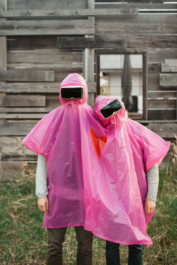 Couple of young adults playing with VR headsets Anonymous Couple Friends Fun Funny Grass Love Virtual Reality Weird Concept Conceptual Day Friendship Headset Odd Outdoors Park People Poncho Real People Summer Technology Vr