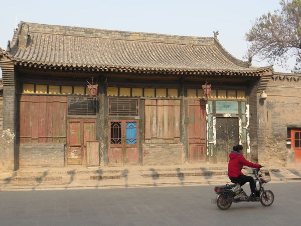 Architecture Building Exterior Built Structure Day Full Length Lady In Red Mode Of Transport Old Building Exterior One Person Outdoors Pingyao China Real People Scooter Transportation