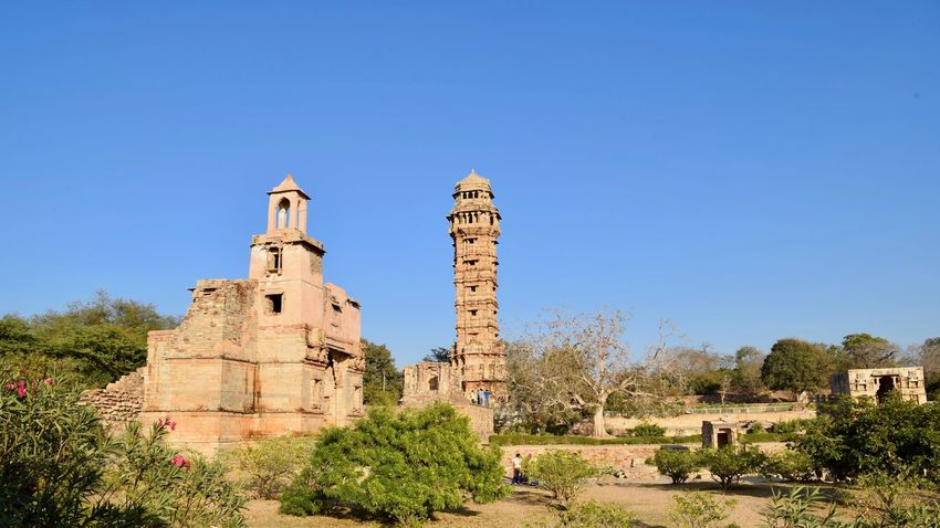 Wide angle view of Tower of Victory Architecture Blue Building Exterior Built Structure Business Finance And Industry Chittorgarh Fort Clear Sky Day History No People Outdoors Pilgrimage Sky Tower Travel Destinations Tree