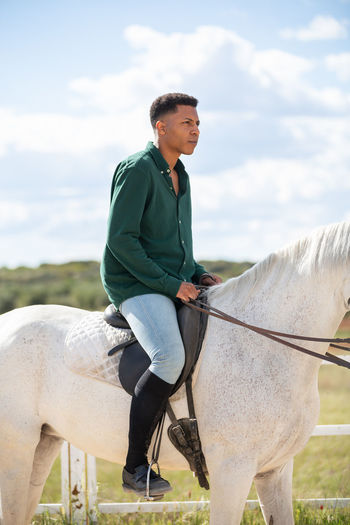Full length of a man riding horse