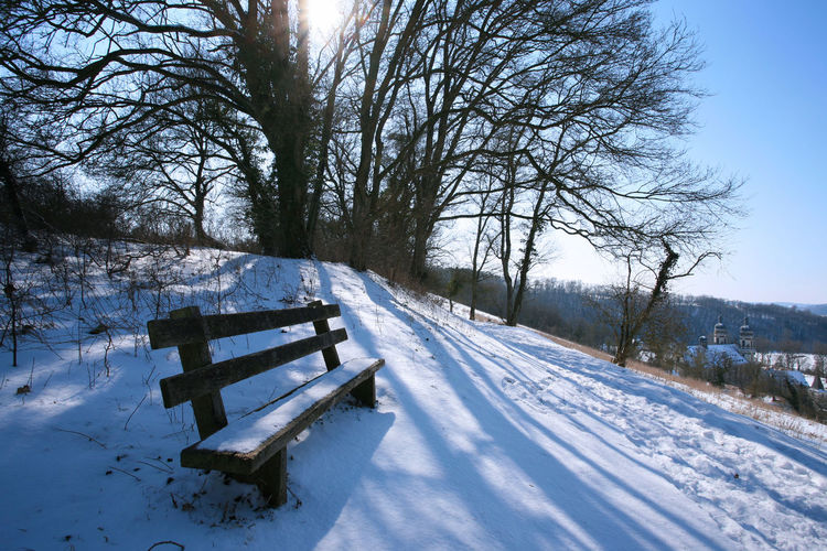 Winter landscape with old wooden bench and trees Backlight Bench Silhouette Travel View Bare Tree Beauty In Nature Cold Temperature Day Idyllic Landscape Nature No People Outdoors Scenics Shadow Sky Snow Sun Sunlight Tranquil Scene Tranquility Tree Winter Wood - Material