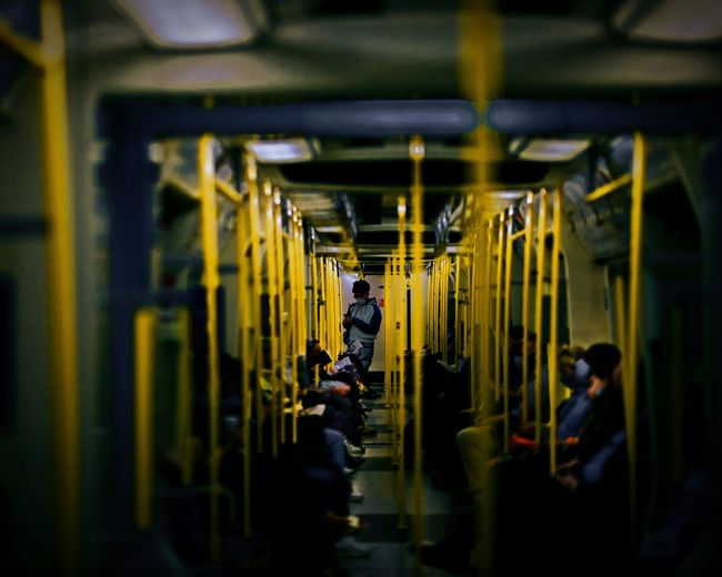 View of people traveling in subway train