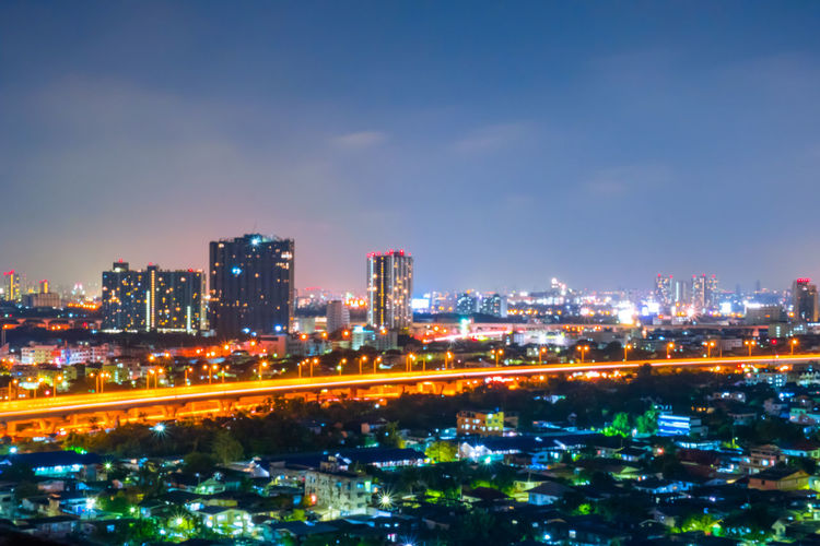 Cityscape from high rise building at night with skyline and clouds. skyscraper in metropolis town with beautiful neon light Bangkok Thailand. City Night Skyline Sky View Cityscape Bangkok Thailand Travel Light Downtown Modern Panorama Road Town Twilight Landscape Building Skyscraper Architecture Evening Tower Tourism Business Beautiful Urban Asian  Landmark Street Neon Metropolis Nighttime Clouds Dark Scenics Dusk Capital Design Top Backgrounds Structure Illuminated Trails High Angle View Urban Skyline Outdoors Office Building Exterior Residential District Cloud - Sky Building Exterior