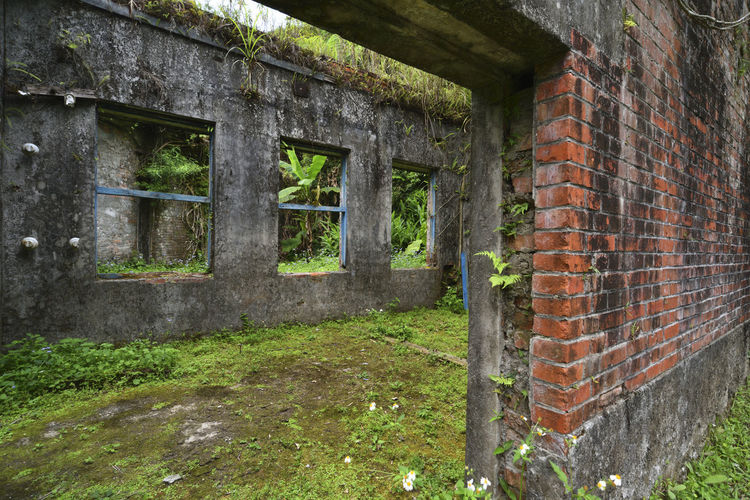Mining site ruins ruins Remains Ruins Abandoned Architecture Brick Brick Wall Building Building Exterior Built Structure Damaged Day Deterioration Grass Green Color House Mining Mining Area No People Old Outdoors Plant Run-down Wall Wall - Building Feature Window