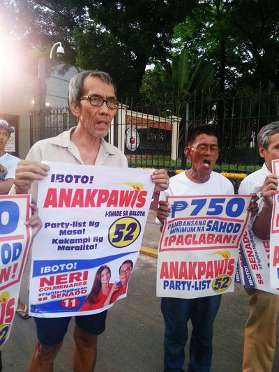 Filipino poor members of a political party demands P750 (about $15) as national minimum wage in front of Philippine congress in Manila.
