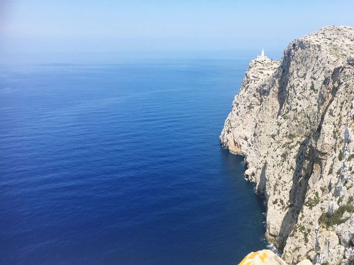 High Angle View Of Rock Formation In Sea Against Sky