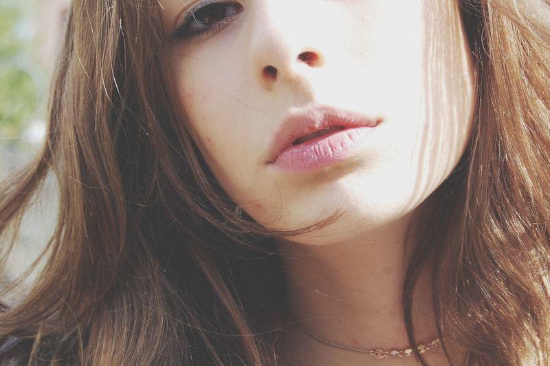 Close-up portrait of beautiful teenage girl