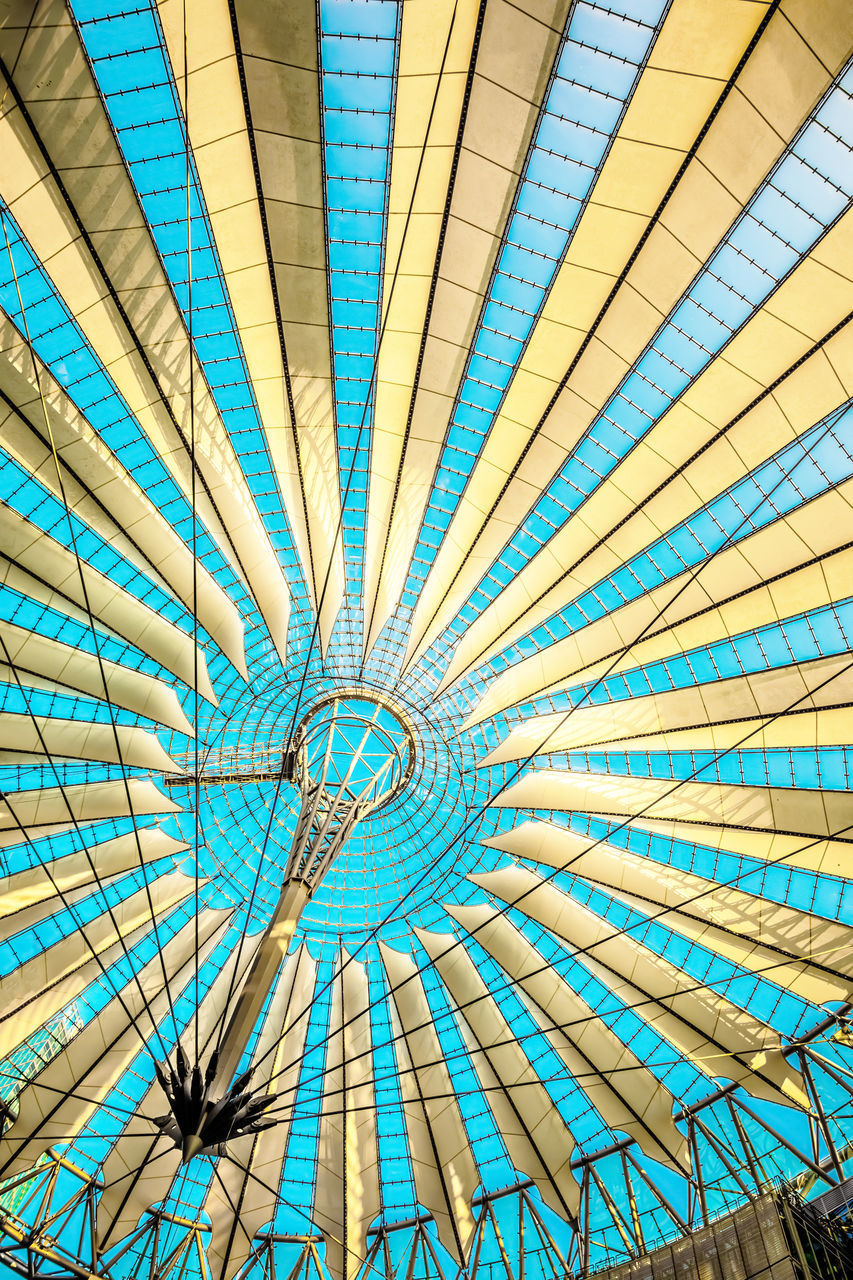 LOW ANGLE VIEW OF BLUE UMBRELLA