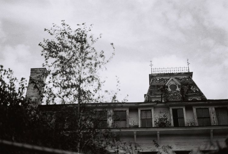 Blast from the past the old abandoned the victorian Wentworth By The Sea hotel 1999 35mm Film Abandoned & Derelict Abandoned Places Derelict Gothic Morbid Victorian Abandoned Abandoned Buildings Architecture Blackandwhite Building Exterior Built Structure Cloud - Sky Gothic Style History Hotel Low Angle View Old Sky The Past Tower Wentworth Window