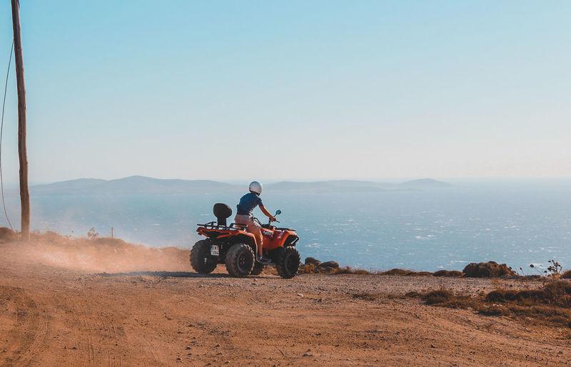 People riding motorcycle on desert