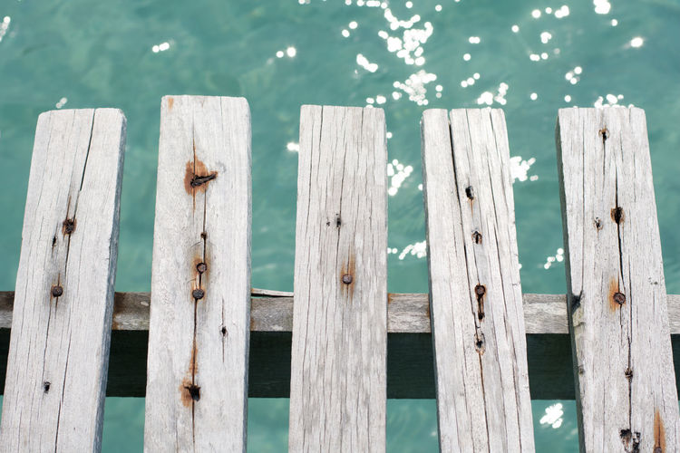 High angle view of wooden fence on pier