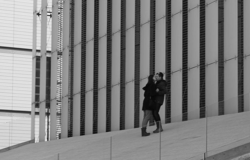 Full length of woman standing in front of building