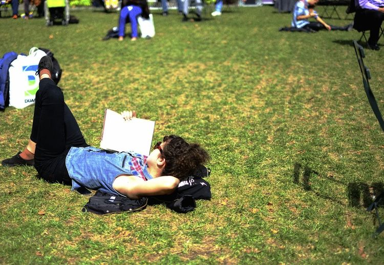 Bryant Park NYC New York Woman Full Length Grass Lifestyles Lying Down Reading Book