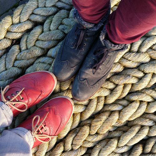 Feet Shoes Rope Red Shipping DocksLow Section Friendship Couples People Standing Structured Material Rough Texture
