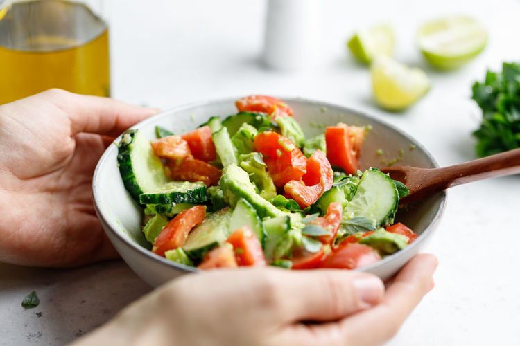 Food And Drink Healthy Eating Food Human Hand Vegetable Hand Freshness Wellbeing Human Body Part One Person Holding Indoors  Salad Bowl Ready-to-eat Real People Lifestyles Fruit Tomato Body Part Meal Finger DIP