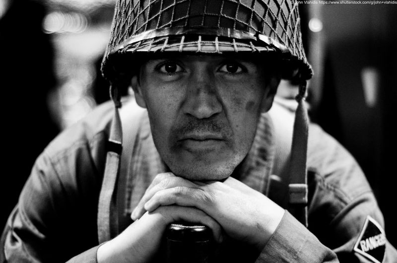 Close-up portrait of soldier wearing helmet