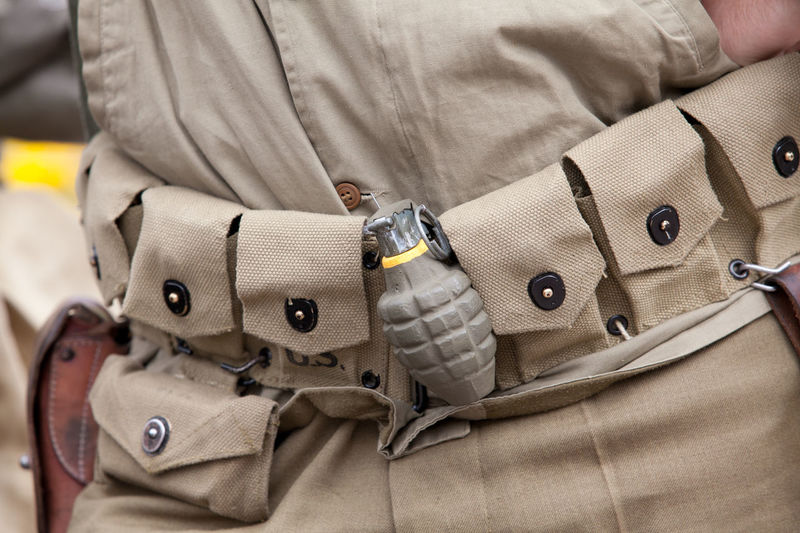 Midsection Of Soldier With Hand Grenade