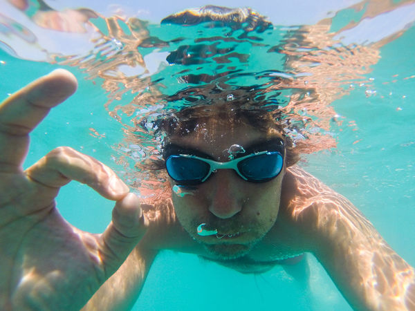 Underwater view of man swimming in the sea Man SCUBA Snorkeling Snorkling UnderSea Bubble Day Floating Googles Leisure Activity Lifestyles Male Ocean One Person Outdoors Real People Sea Snorkel Summer Swimming Swimming Underwater Vacation Water Young Adult