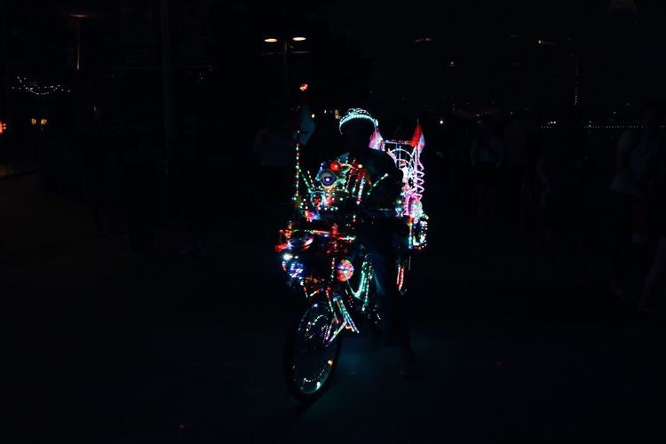 The new old; Pioneer riding on a motorcycle that is decorated with colourful neon lights and blasting loud traditional music. Only in Singapore. Only Men Celebration Christmas Decoration Full Length Real People Night One Person Men Illuminated Outdoors Adult People Singapore Art EyeEmNewHere Modern VSCO EyeEm Selects Multi Colored Neon Laser Neon Lights Motion