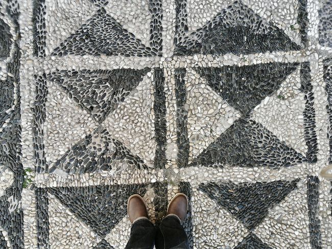 """""""New shoes"""". By chance they are. However this is a Fault as I was trying to capture as much of this Typical Liguria-n Churchyard. Black And White Mosaic of Sea Shingles. Patterns Textures And Surfaces Stones Shoes (I actually dislike photos of feet, bare or with shoes, except those by @ByFetish and alike ☺). Point And Shoot Eyeemfilter F3 Simplicity"""