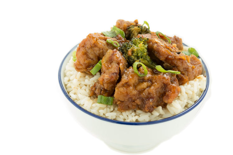 Close-Up Of General Tso Chicken Over White Background