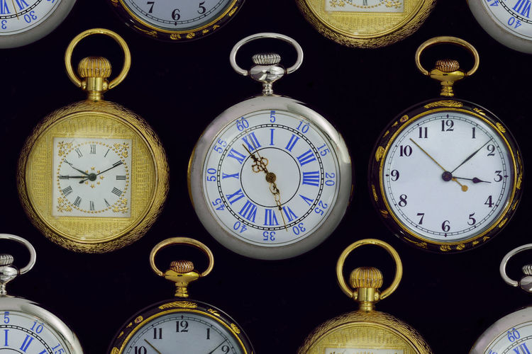 High angle view of pocket watches on table