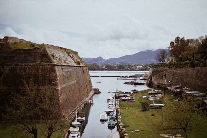 Old Fortress Wall, Corfu. Mountain Water No People Scenics Built Structure Architecture Fortress Wall Fortress Old Transportation Overcast EyeEm Gallery Analogue Photography Film Photography Filmisnotdead Expired Film Tranquility Island Boat Sea Greece Travel Destinations Bridge Calm Day