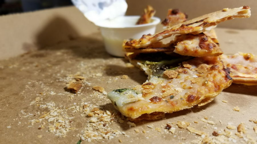 Close-up of pizza leftovers in box