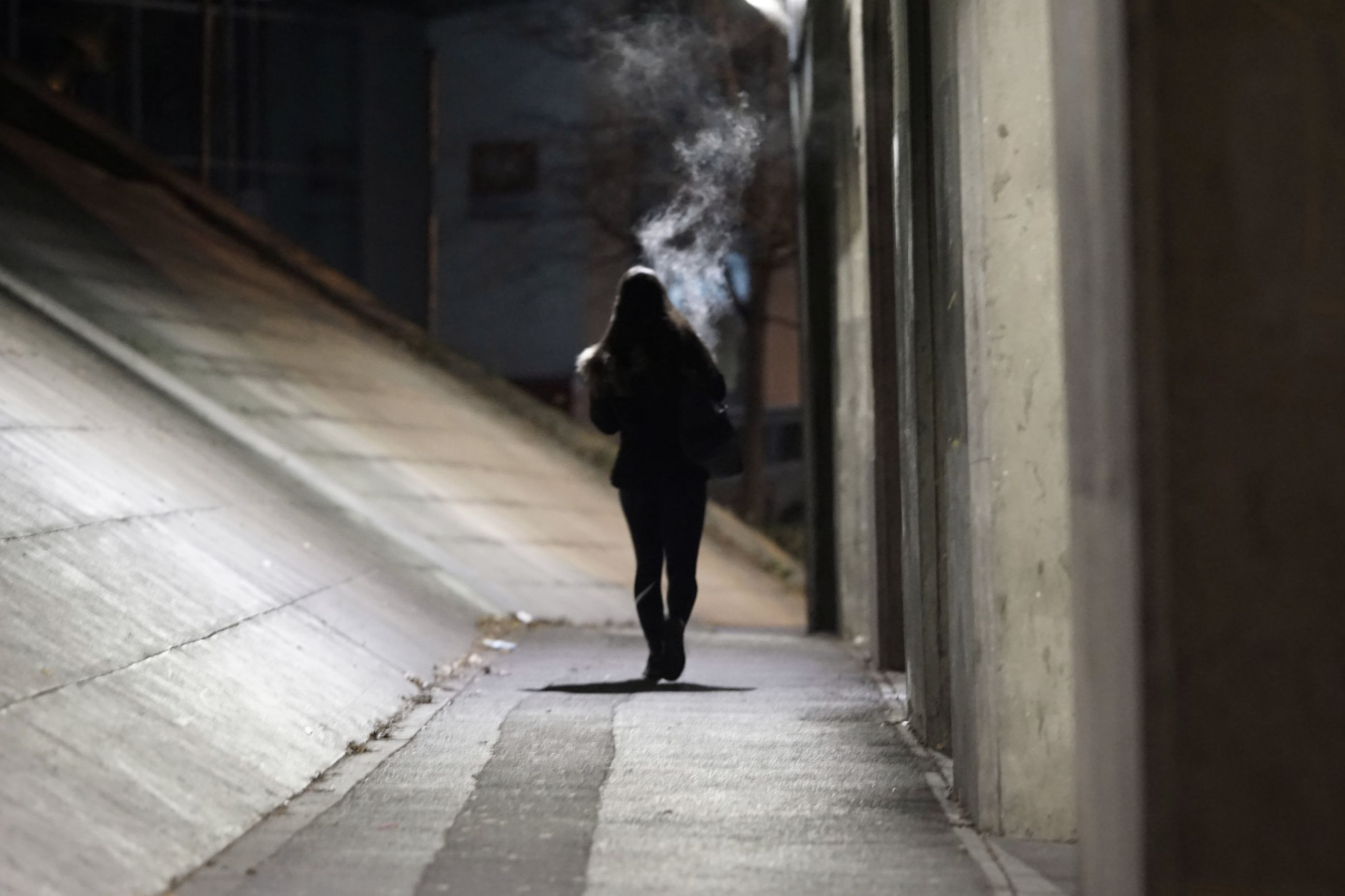 one person, smoke - physical structure, full length, architecture, real people, walking, motion, lifestyles, men, adult, built structure, sign, day, direction, standing, warning sign, communication, indoors