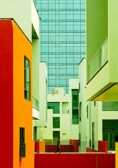 The colorful forest of buildings Architecture Built Structure Building Exterior Building Day Multi Colored Window City Outdoors Residential District Green Color People Red Modern Men Real People Education Glass - Material Incidental People Women