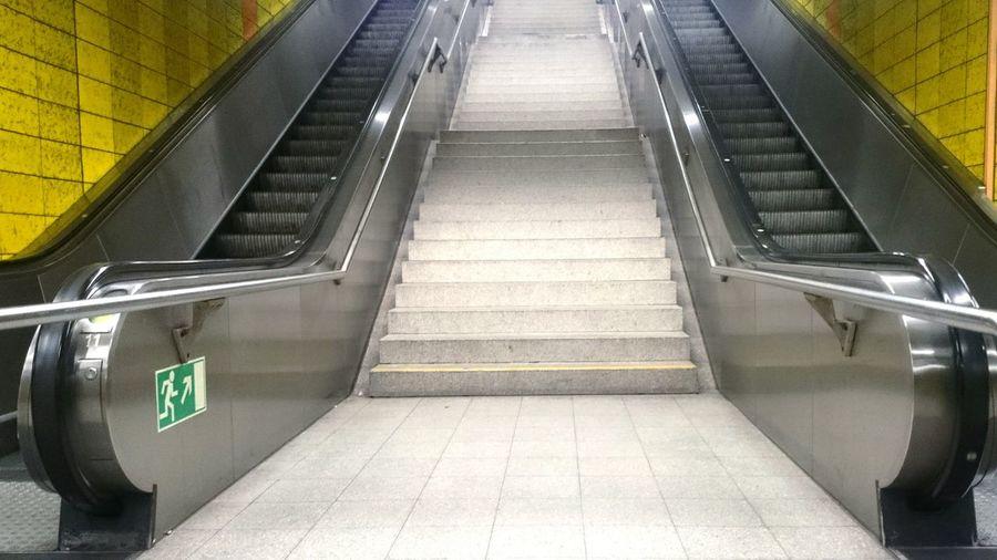 Staircase on escalator