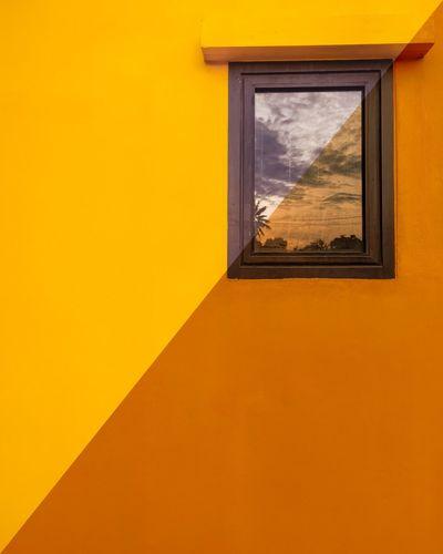 Yellow window of orange building