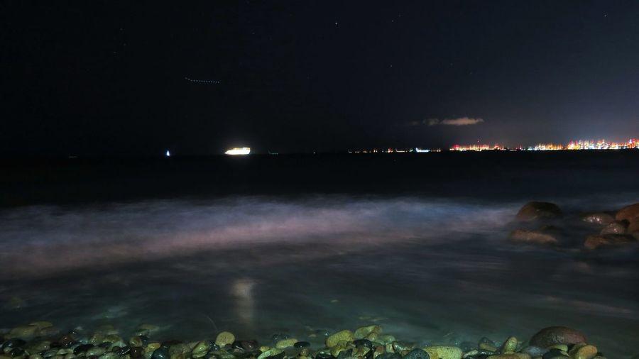 Scenic view of illuminated lake at night