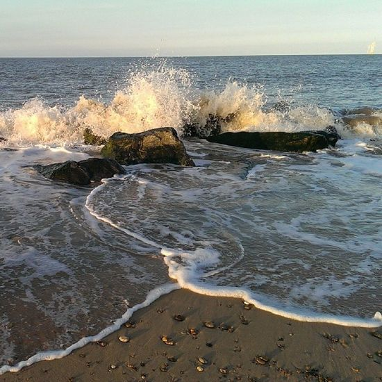 Nofilters Caister Caisteronsea Seaside sand rocks tide sky blue bluesky beach htcone htc1 springevening spring waves sea spray splash peaceful pebblesphotography eveningwalk