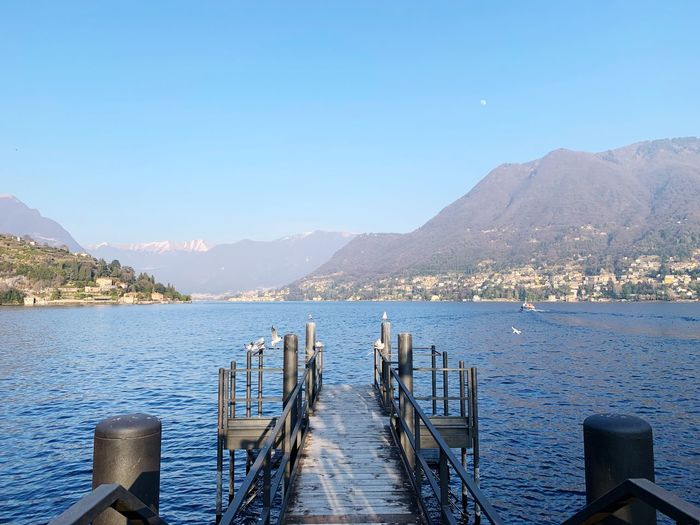 Lago di Como Lake View Lake Water Sky Mountain Scenics - Nature Clear Sky Beauty In Nature Mountain Range Nature Copy Space Tranquility Nautical Vessel Transportation Outdoors Mode Of Transportation Non-urban Scene No People Wood - Material Tranquil Scene Day Pier