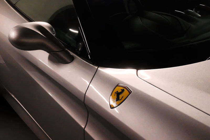 Ferrari side Detail with Badge Arts Culture And Entertainment Auto Post Production Filter Car Car Interior Cropped Documentary Photography Ferrari Glass - Material Indoors  Land Vehicle Mirror Mode Of Transport Music Old-fashioned One Person Part Of Reportage Street Photos Taking Fotos Images Photographic Camera Lens Architectural Design Building Structual Support Detail Of Tower Block In Sunshine Blue Sk Shiny Side Detail Badge Black Horse Sports Car Italian Prancing Black Horse Technology Transparent Transportation Vehicle Interior