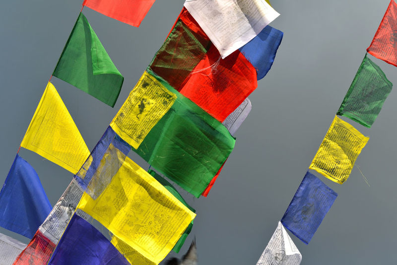 Buddhist Tibetan prayer flags blowing in the wind Buddhist Faith Kathmandu Kathmandu, Nepal Text Blowing Buddhism Buddhist Temple Celebration Day Flag Flags Flags In The Wind  Hanging Mantra Mantras Message Multi Colored Nepali  No People Om Mani Padme Hum Prayer Flag Prayer Flags  Sky Swayambhunath