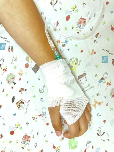Cropped Hand With Iv Drip On Hand
