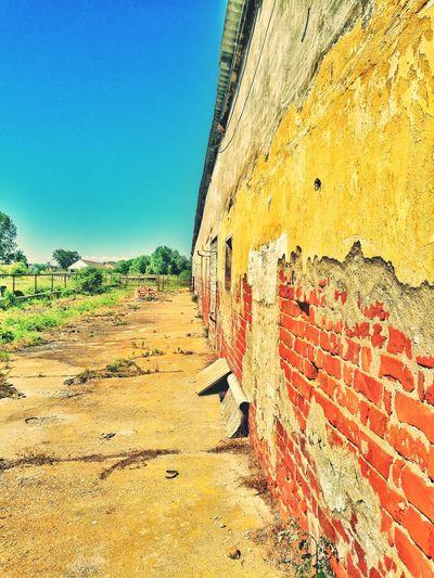 Brick wall against clear sky