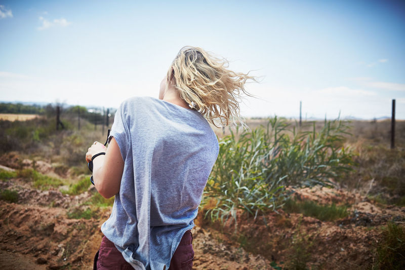 Adult Adults Only Blond Hair Casual Clothing Day Denim Jacket Field Focus On Foreground Leisure Activity Nature One Person One Woman Only One Young Woman Only Outdoors People Rural Scene Sky Standing Young Adult Young Women